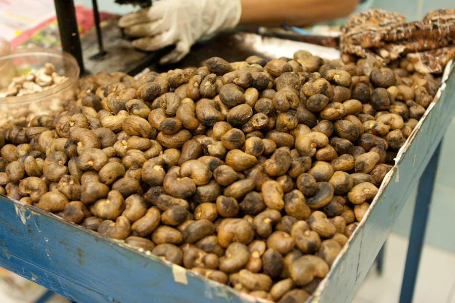 Worker shelling cashew nuts