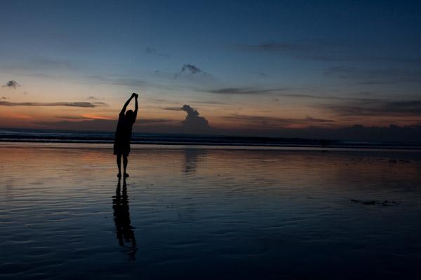 George doing yoga on the beach, Bali