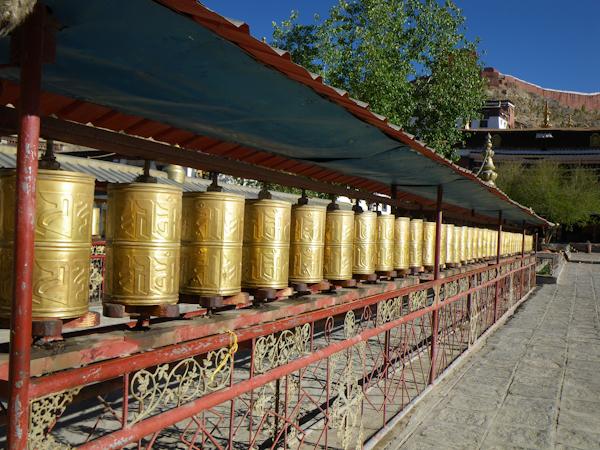 Prayer wheels near the entrance of Pelkor Chode Monastery