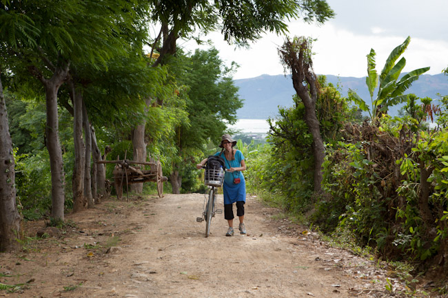 Heidi Pushing her Bicycle up the Hill Toward the Forest Monastery