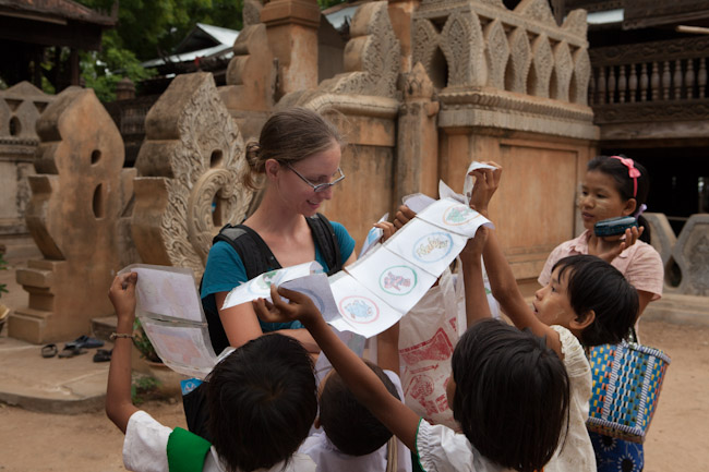 Kids Trying to Sell Their Drawings Outside a Temple