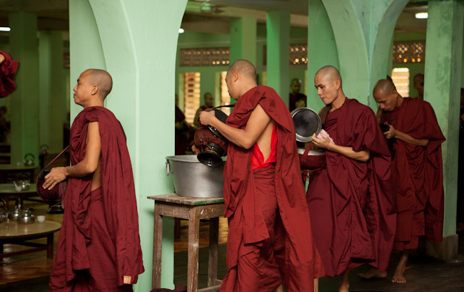 Monks Emptying Their Alms Bowls After Lunch